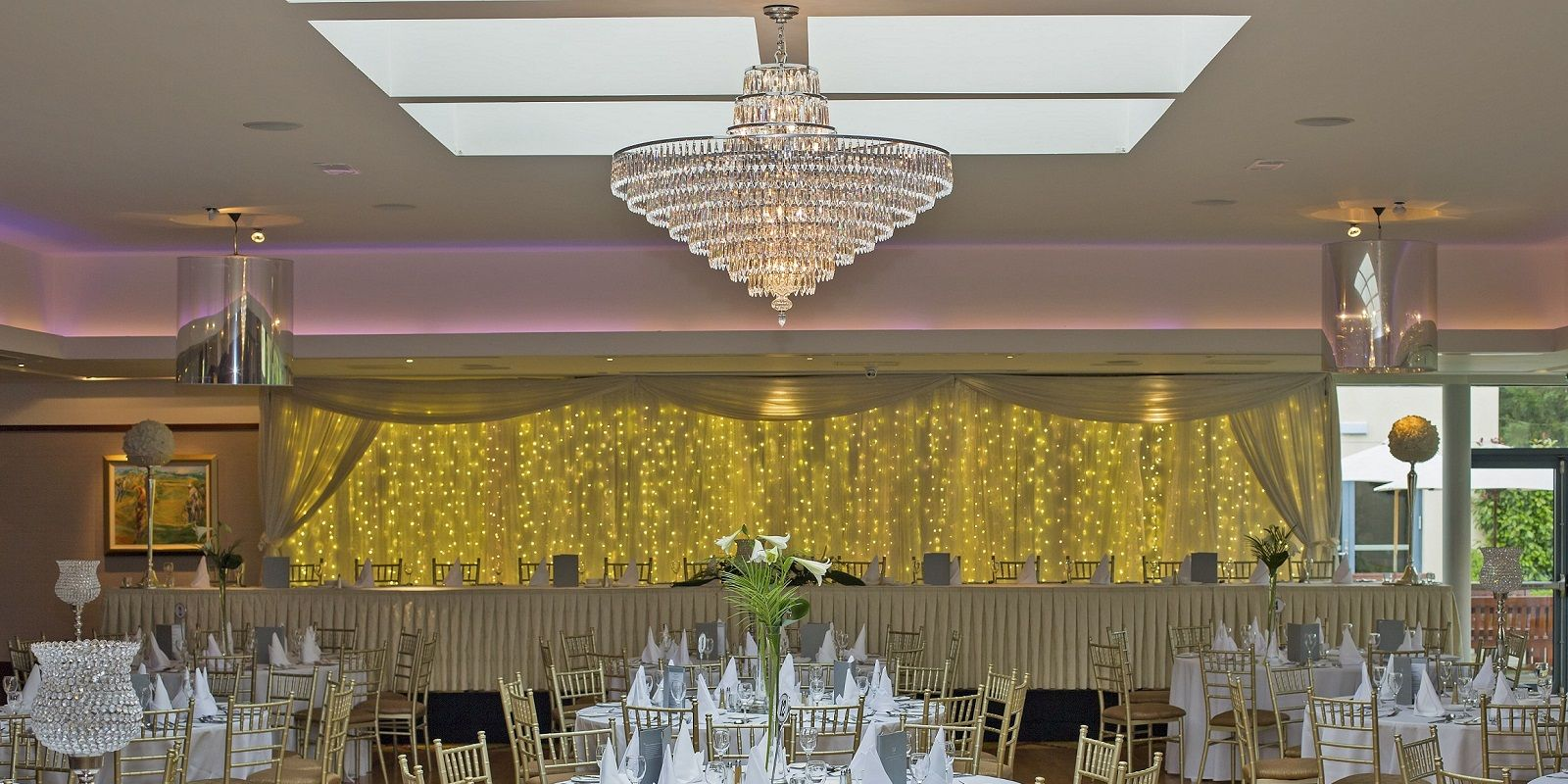 centre view of the garden room with Chandelier and top table